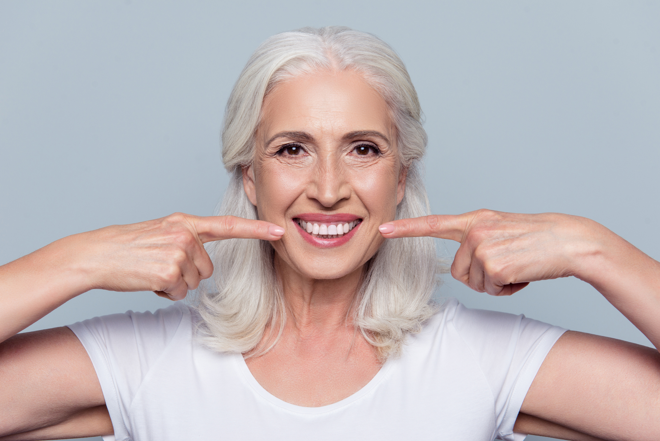 woman happy because of new dental impants
